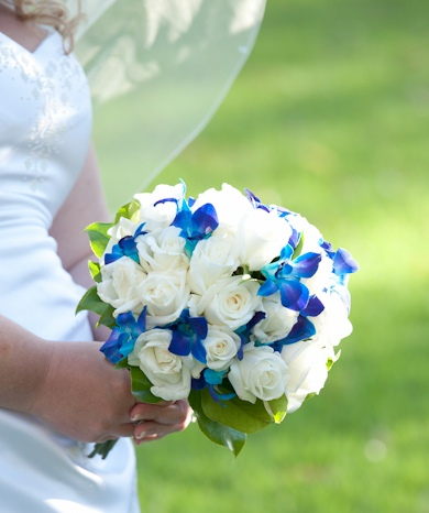 blue orchids and white rose posies. A popular choice www.blushbloomsandevents.com.au